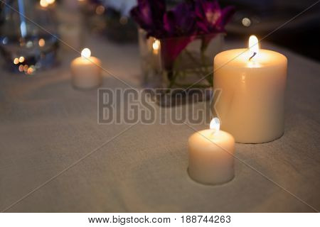 Close up of lit candles on table at restaurant
