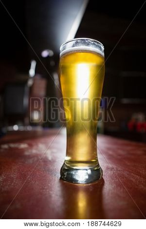 Close-up of pilsner beer glass on a table