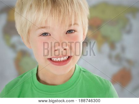 Digital composite of Boy smiling against blurry map
