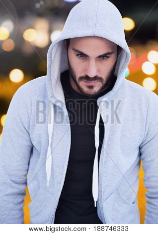 Digital composite of Man with hood against night city