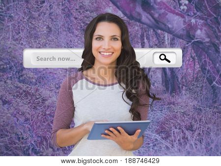 Digital composite of Woman on tablet with search bar and pink forest mysterious background