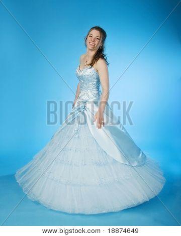 teen girl wearing blue prom dress