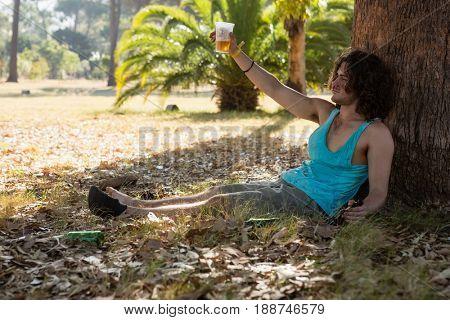 Unconscious drunken man having beer in the park