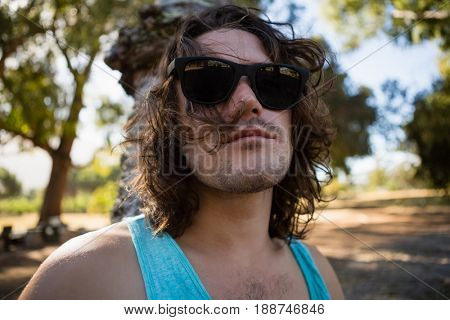 Drunken man in sunglasses at a park