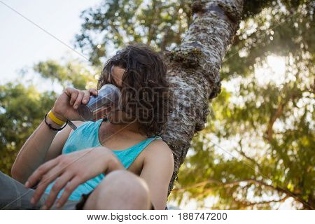 Unconscious man drinking beer in the park