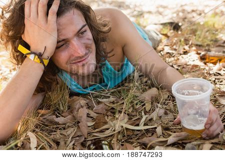 Unconscious drunken man lying in the park