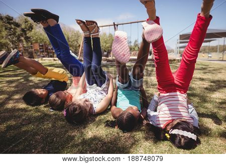 Schoolkids playing in park on a sunny day