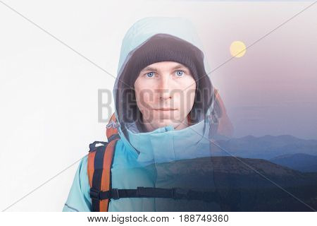 Face of young man hiker and evening hilly landscape with moon. Double exposure effect photography with copy space.