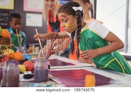 Schoolkids practicing drawing in school