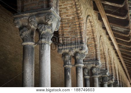 Columns and arches of cloister in old Dominican monastery Couvent des Jacobins in Toulouse, France. Architectural details.