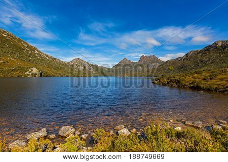 Ripples on clear water surface at Dove Lake with Cradle mountain in background