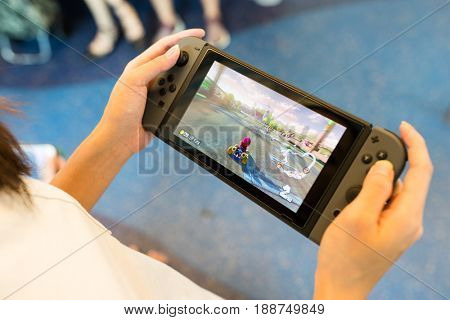 Hong Kong, 19 May 2017 -:Woman Playing mario kart 8 on Nintendo Switch inside traing compartment