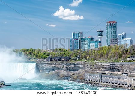 NIAGARA FALLS, NEW YORK, USA - MAY 20: American side of Niagara Falls waterfall, view of Canadian side from New York state, USA