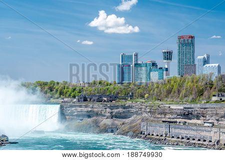 NIAGARA FALLS, NEW YORK, USA - MAY 20: American side of Niagara Falls waterfall, view of Canadian side from New York state, USA