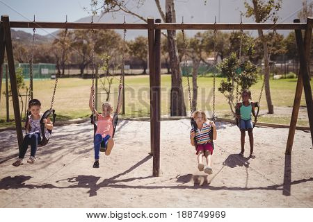 Schoolkids playing in playground of school
