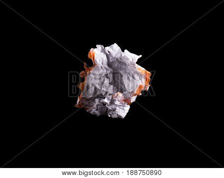 Crumpled piece of white blank squared paper exercise book on black background.