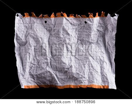 Crumpled piece of white blank squared paper exercise book on black background. Note paper for text writing.