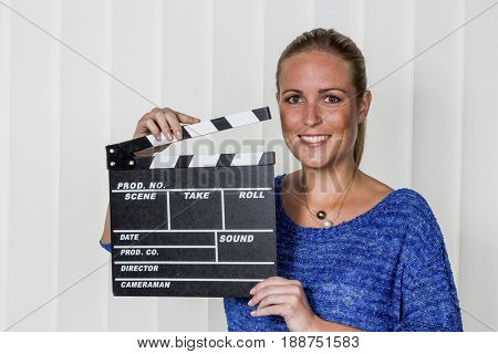 woman with clapperboard