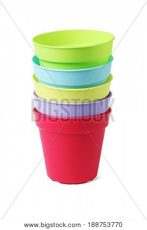 Stack of Colourful Plastic Flower Pots on White Background