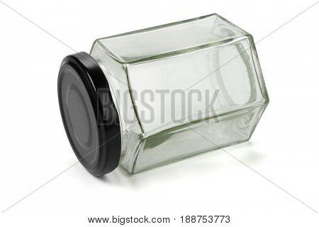 Hexagonal Shape Glass Jar Lying on White Background