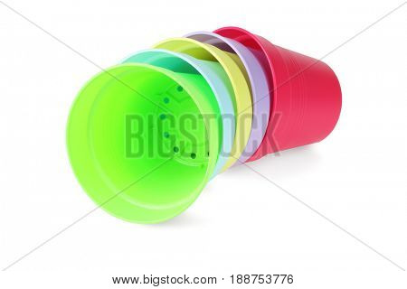 Plastic Colourful Flower Pots Lying on White Background