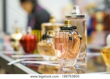 Perfume bottle on showcase in shop