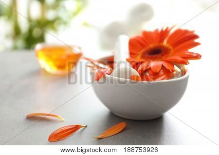 Beautiful spa composition with flower in bowl on table