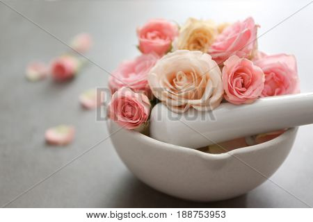 Beautiful spa composition with flowers in bowl on table