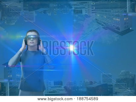 Digital composite of up side down city. futuristic woman with futuristic glasses and a lot of flares