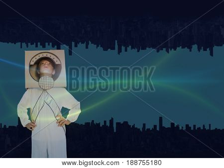 Digital composite of up side down city. green and blue lights in the sky with astronautic boy