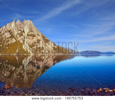 Picturesque mountain and lake in Bariloche.  The concept of exotic and extreme tourism. Summer in  Argentina