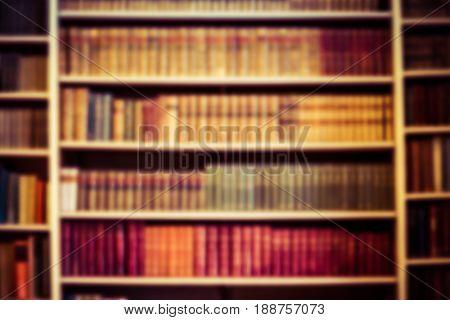 blurred background bookshelf full of books. Concept of library.