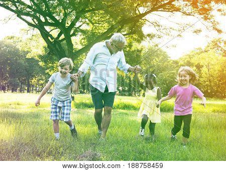 Grandfather Enjoy Grandchildren Outdoors Together poster