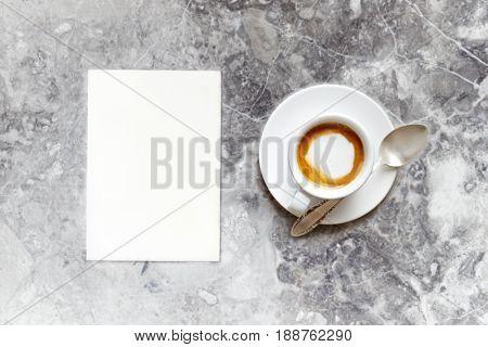 Cup of Espresso Macchiato and a blank Paper Sheet