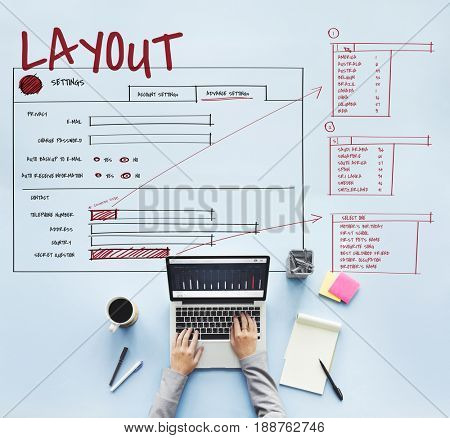 Hands working on laptop network graphic overlay background