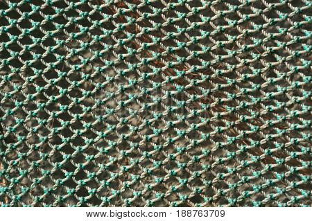 Fishing net texture. Abstract green textured background.