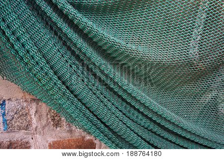 Fishing net hanging on a wall.
