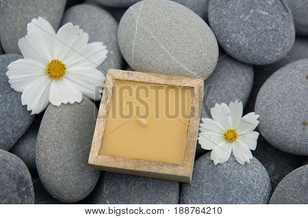 Pile of gray stones with two gerbera