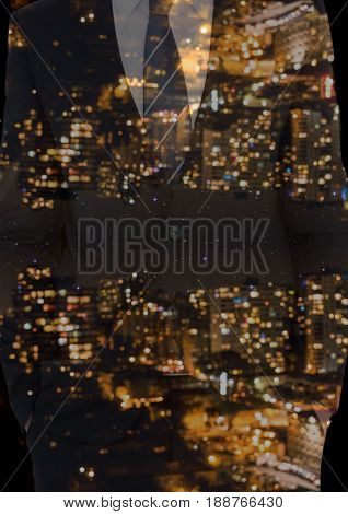 Digital composite of up side down city at night on a suit