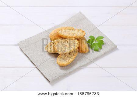 pile of crispy rusks on beige place mat