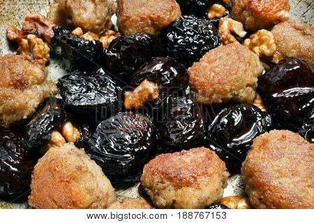 Meat with prunes. Black plum with nuts and meat
