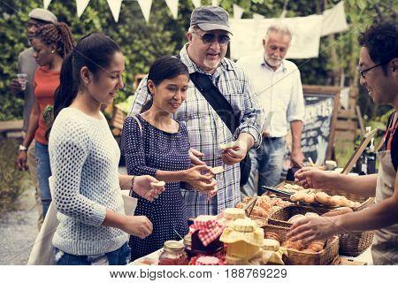 Group of Diverse People Holding Bread Testing Jam Taste