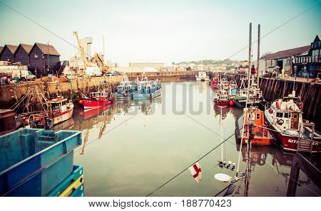 WHISTABLE, UITED KINGDOM - January 21, 2017: Fishing Boats and fisherman's sheds in Whitstable Harbour
