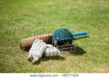 High angle view of cricket equipment on field during sunny day