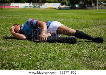 Injuerd rugby player lying on playing field