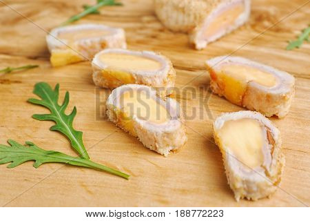Delicious Cordon Bleu chicken on cutting board