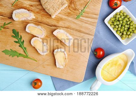 Delicious Cordon Bleu chicken slices on cutting board