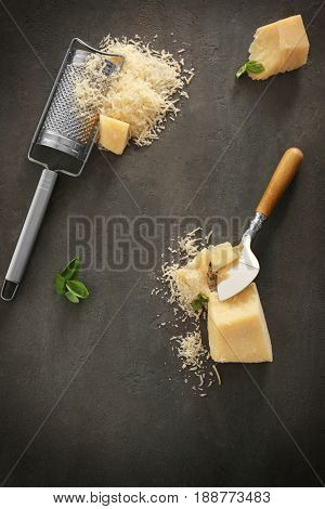 Grater and cheese on table