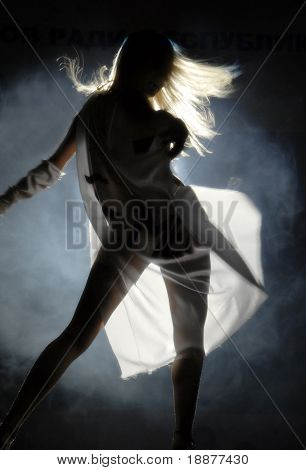 silhouette of dancer in a cloak. Good use for background of party ticket, card and posters