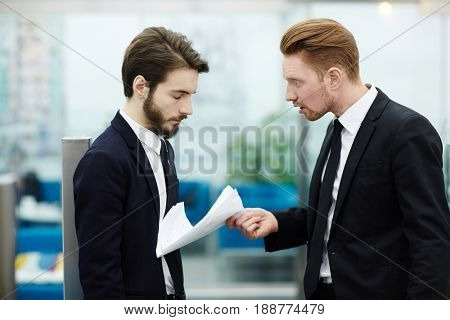 Boss reproaching one of employees after work